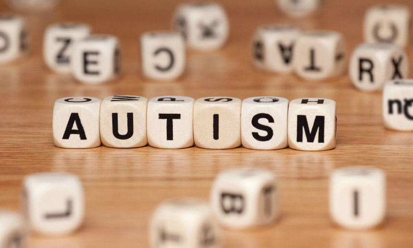 The word AUTISM spelled out in letter cubes.